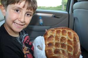 "My Turkish ""little brother"" holding some of the special Ramazan bread only offered in this month."