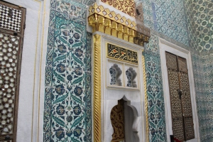 Every wall covered in intricately painted tiles.